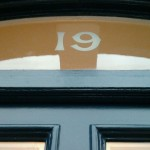 19 numeral Barons Court house sign NGS London