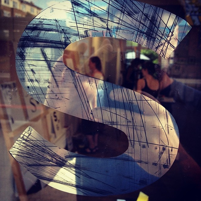 Mirrored lettering with urban scrape detail Nick Garrett Signs