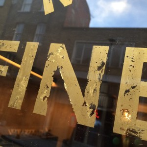 Distressed gold NGS signwriting London