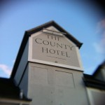 The County Hotel with border